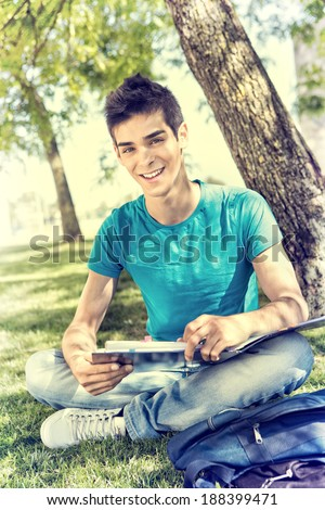 Young student studying at the school garden - stock photo
