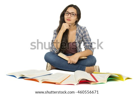 young student surrounded by books