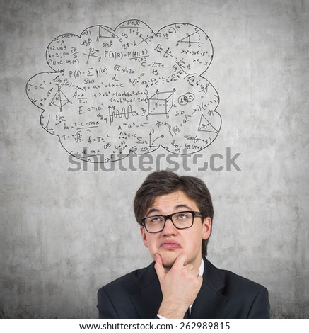 young student thinking about learning, close up - stock photo