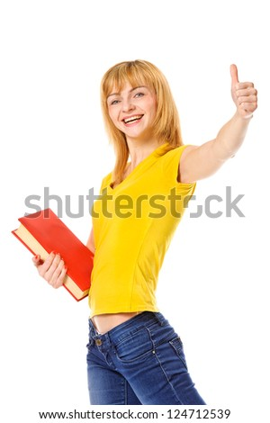 Young student with book in hand giving thumb-up gesture. Isolated on white
