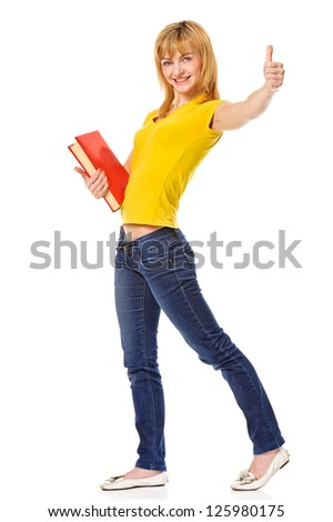 Young student with book in hand giving thumb-up gesture, isolated on white