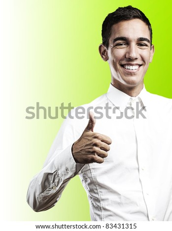 young student with thumbs up on a blue background