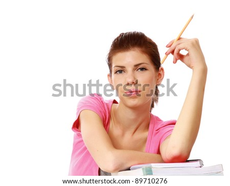 Young student woman doing her studies isolated on white background - stock photo
