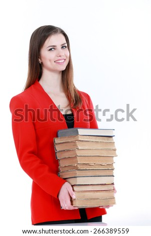 Young student woman holding lots of books