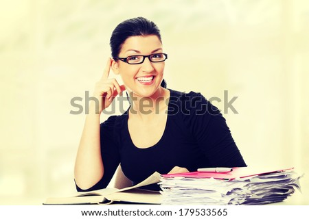 Young student woman learning at the desk. - stock photo
