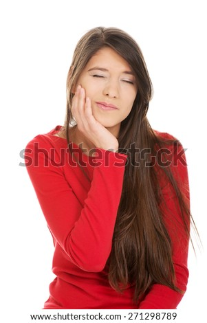 Young student woman suffering from tootache. - stock photo