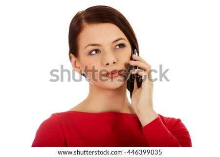 Young student woman talking through a mobile phone - stock photo