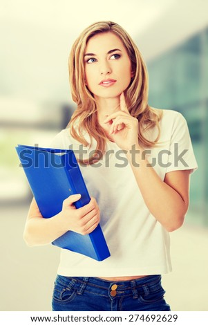Young student woman thinking about some concept - stock photo