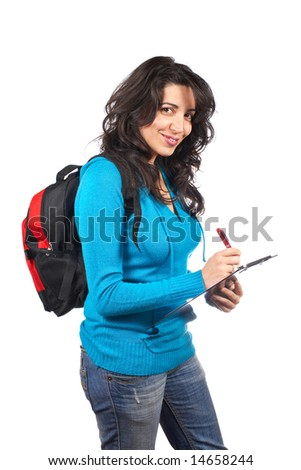 Young student woman with a black backpack  writing on white background