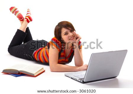 Young student woman with book and laptop isolated on white - stock photo