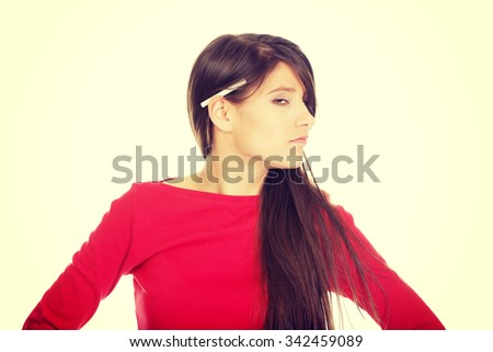 Young student woman with cigarette on ear. - stock photo