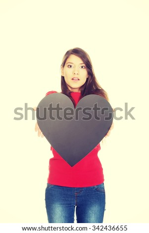 Young student woman with heart made from paper. - stock photo