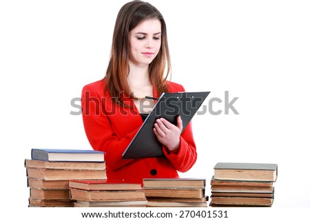 Young student woman with lots of books studying for exam - stock photo