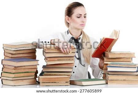 Young student woman with lots of books studying for exam