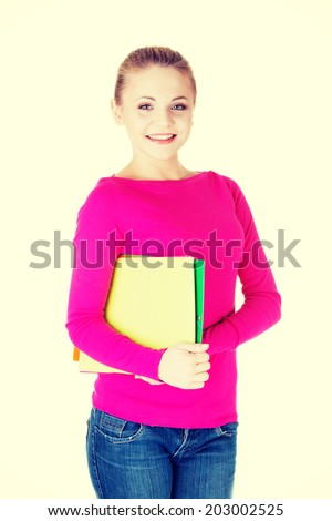 Young student woman with workbook. Isolated on white. - stock photo