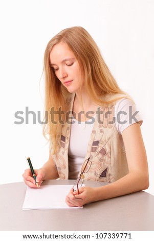 Young student woman writing in notebook - stock photo