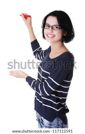 Young student woman writing something on abstract screen with red marker - stock photo