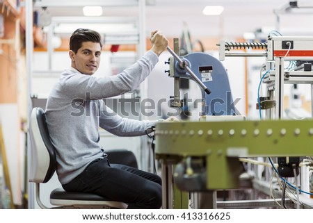 Young student working on a science project on a machine - stock photo