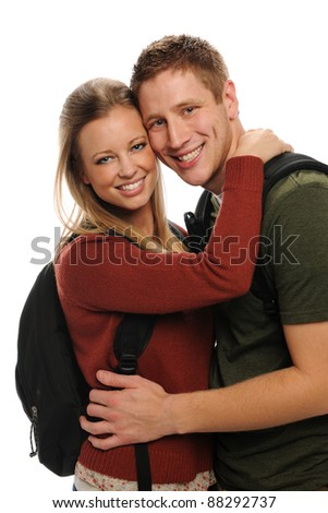 Young students couple smiling isolated on a white background - stock photo