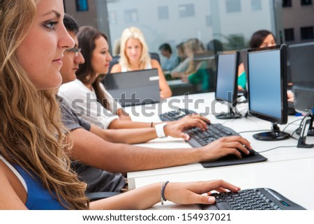 Young students having training course in classroom. - stock photo