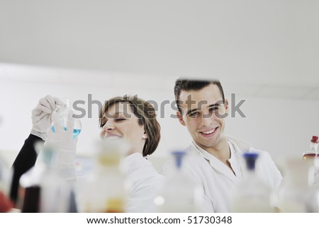 young students in bright lab - stock photo