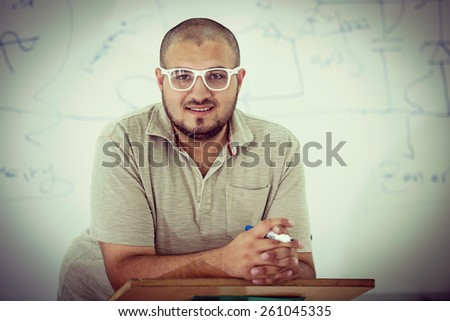 Young students in classroom - stock photo