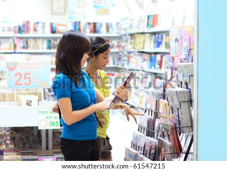 young students shopping for books and magazines - stock photo