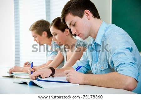 young students studying together in a classroom