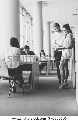 Young students studying together in a library