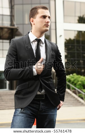 young stylish businessman near office building - stock photo