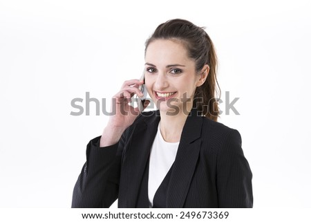 Young stylish Businesswoman using mobile phone. Isolated on white background. Caucasian brunette female model. - stock photo