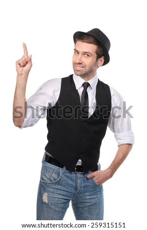 Young stylish caucasian man pointing with his finger upwards. Isolated on white background - stock photo