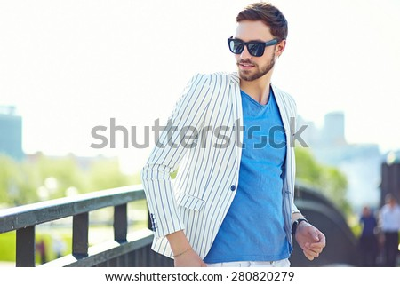 Young stylish confident happy handsome businessman model  in suit hipster cloth lifestyle in the street - stock photo