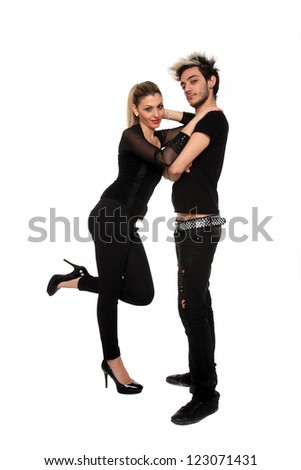 young stylish couple dressed on black isolated on a white background