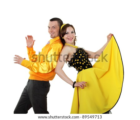 young stylish couple in bright colour wear dancing - stock photo