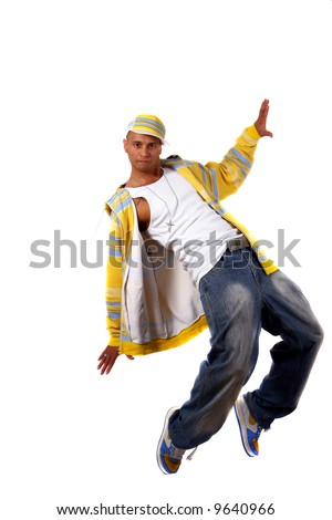 Young Stylish Dancer Young man with clothes in hip-hop style showing a dance move while jumping over pure white background. - stock photo