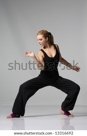 young stylish female dancing modern ballet dance