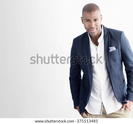 Young stylish handsome confident man in casual suit - stock photo