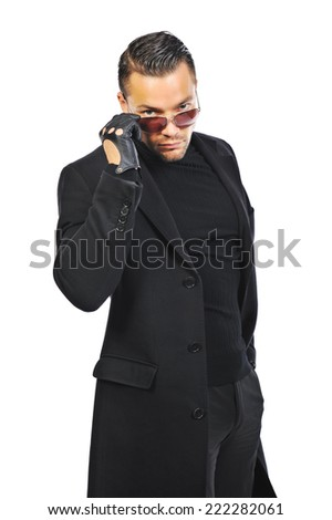 Young stylish handsome man in coat isolated on white background - stock photo