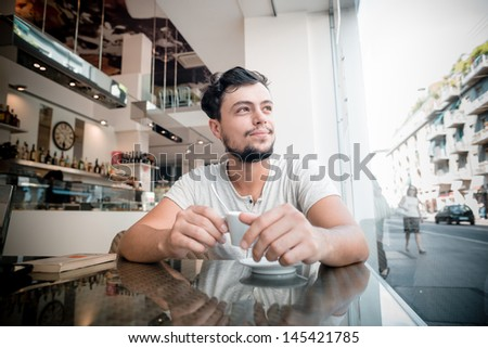 young stylish man at the bar with coffee - stock photo