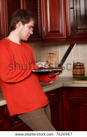 Young stylish man home with laptop - stock photo