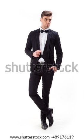Young stylish man in a suit and bow tie.