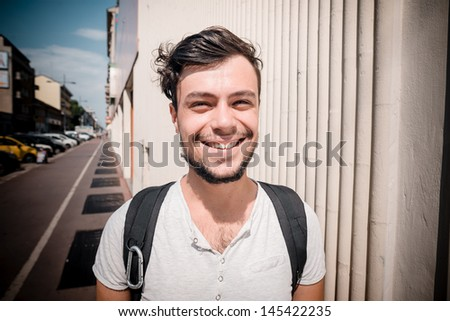 young stylish man in the city - stock photo