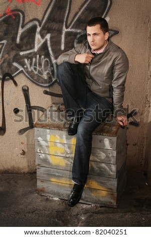young stylish man posing outdoors - stock photo