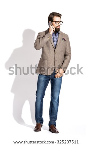 Young stylish man with a beard, dressed in a studio - stock photo