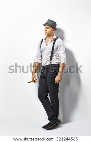 Young stylish man with cigar - stock photo