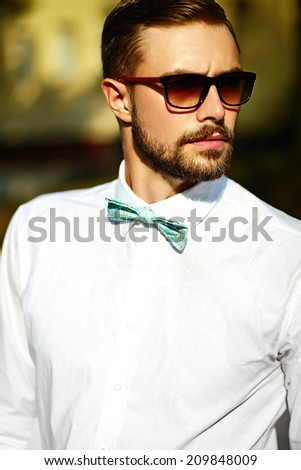 Young stylish sexy handsome model man in casual cloth lifestyle in the street in glasses - stock photo