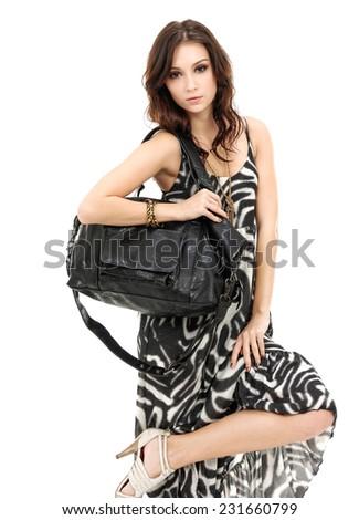 Young stylish slim woman with handbag posing  - stock photo