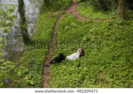 Young stylish woman  having rest in the park