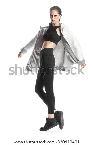 young stylish woman in parka in elegance pose on white - stock photo